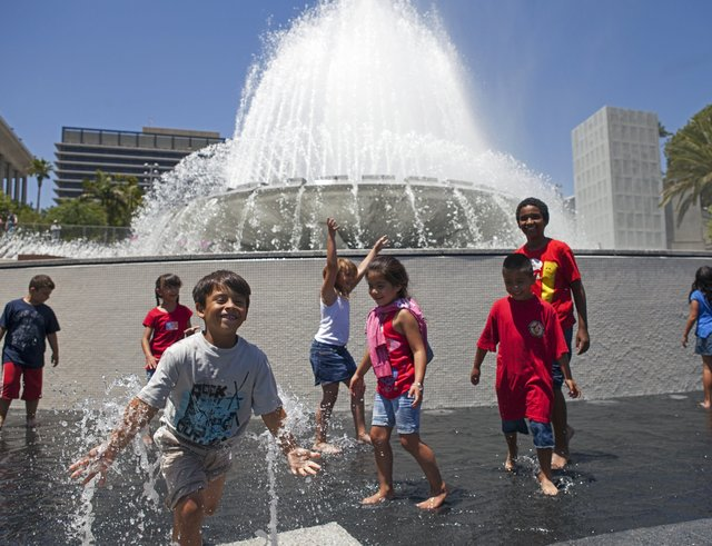 Kids play in front of a large municipal fountain in Grand Park, Los Angeles.