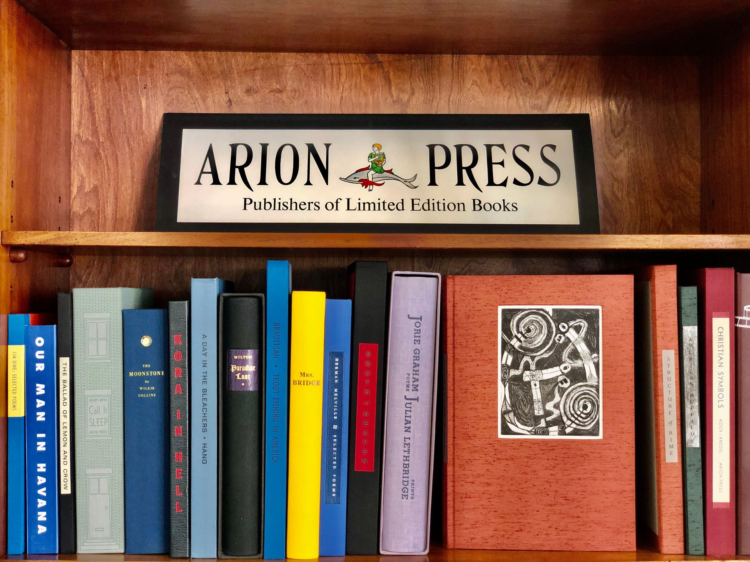 Books on shelf at Arion Press